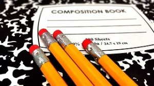composition book and pencils